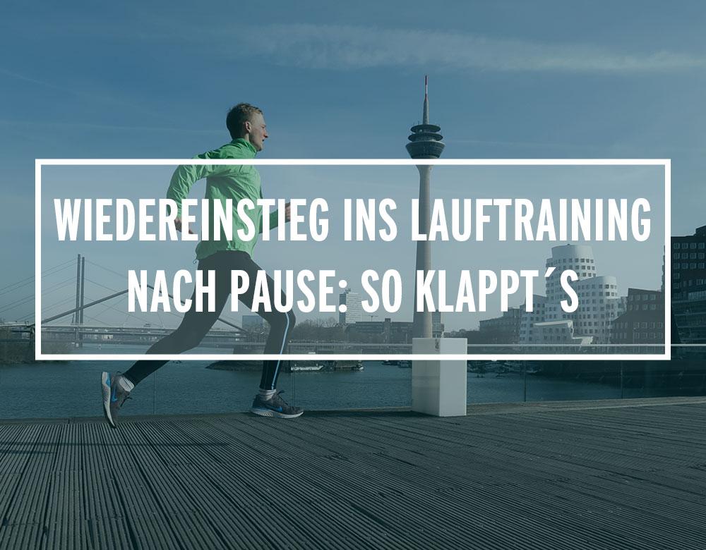 Läufer auf einer Brücke im Düsseldorfer Medienhafen
